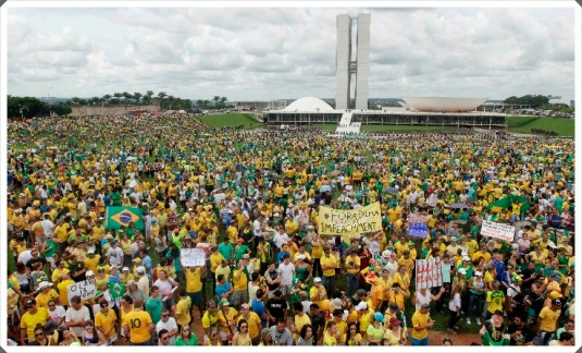 Demonstrators hold a banner during a protest against Brazil's President Dilma Rousseff in front of the Brazilian congress in Brasilia